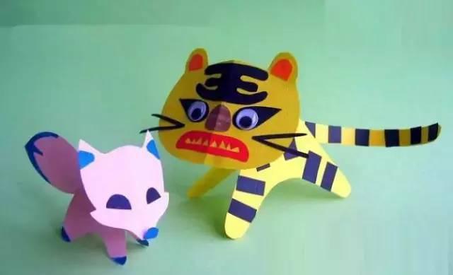 这些简单的动物手工  让孩子们过一把瘾  剪纸老虎  准备材料:彩纸,剪